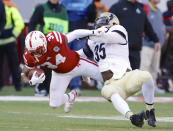 Nebraska running back Terrell Newby (34) is tackled by Purdue linebacker Ja'Whan Bentley (35) in the first half of an NCAA college football game in Lincoln, Neb., Saturday, Nov. 1, 2014. (AP Photo/Nati Harnik)