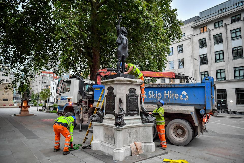 Contractors prepare to remove A Surge of Power (Jen Reid) 2020, by prominent British sculptor Marc Quinn, which has been installed in Bristol on the site of the fallen statue of the slave trader Edward Colston.