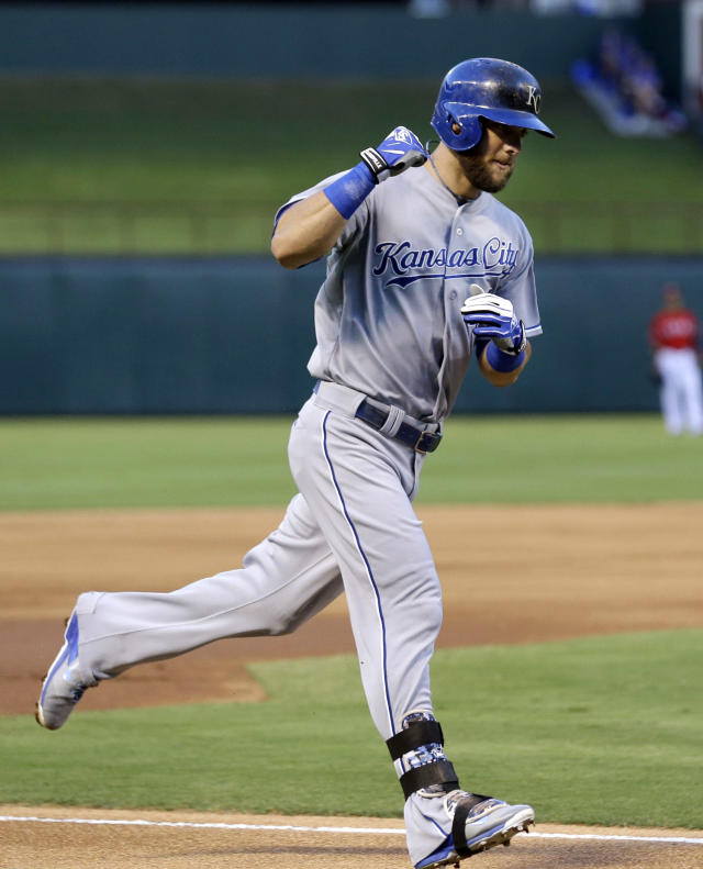 Kansas City Royals Alex Gordon rounds the bases after hitting a solo home run during the first inning of a baseball game against the Texas Rangers, Saturday, Aug. 23, 2014, in Arlington, Texas. (AP Photo/LM Otero)