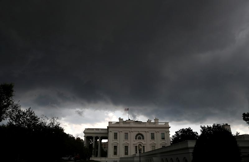 Storm clouds gather over the White House in Washington, D.C., U.S. August 13, 2018. REUTERS/Leah Millis