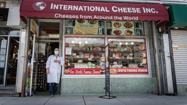 A person stands in front of International Cheese Inc., a store in Ottawa's ByWard Market, on May 11, 2021.