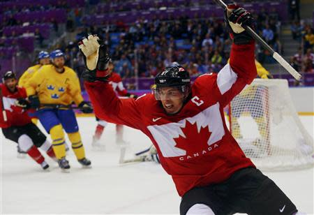 Canada's Sidney Crosby (front) celebrates after scoring against Sweden during the second period of their men's ice hockey gold medal match at the Sochi 2014 Winter Olympic Games