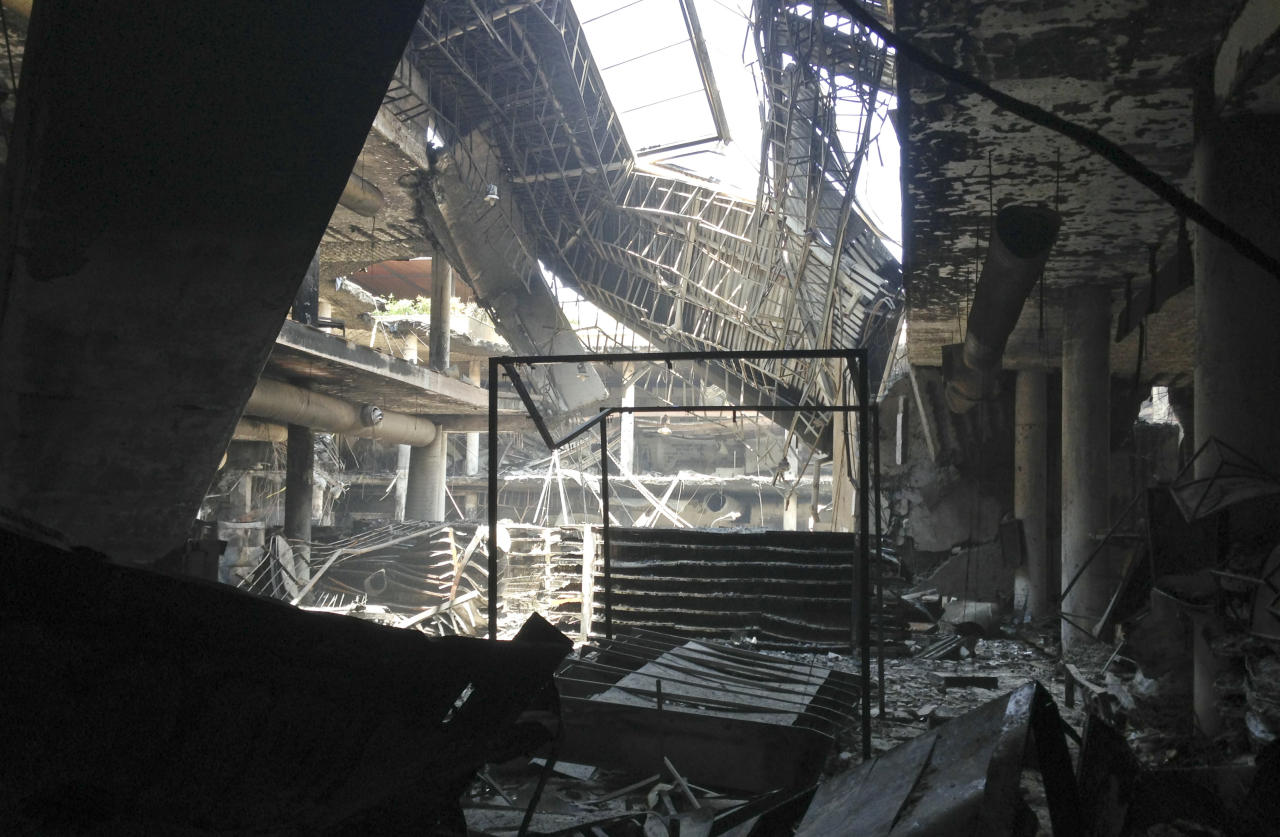 The remains of the Nakumatt supermarket in the Westgate Mall in Nairobi, Kenya Tuesday, Oct. 1, 2013. Kenyan President Uhuru Kenyatta says Kenya will keep its troops in Somalia to help that country's beleaguered government battle the armed Islamic extremist group al-Shabab, which attacked the mall in Nairobi on Sept. 21 claiming at least 67 lives. (AP Photo/Jason Straziuso)