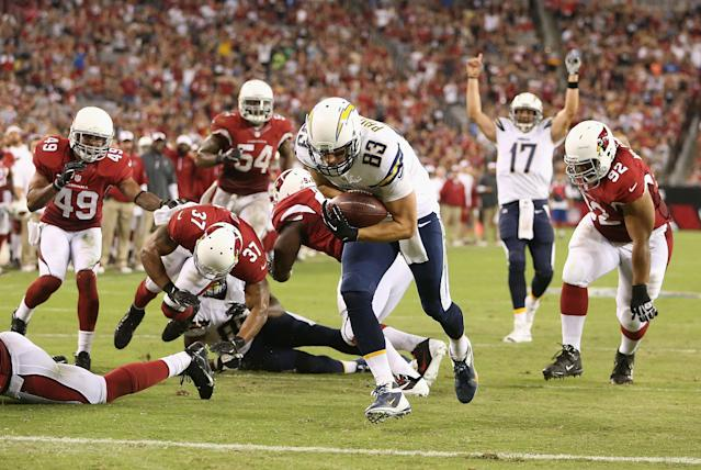 GLENDALE, AZ - AUGUST 24: Tight end John Phillips #83 of the San Diego Chargers scores a 3 yard second quarter touchdown on a fumble recovery against the Arizona Cardinals during the preseason NFL game at the University of Phoenix Stadium on August 24, 2013 in Glendale, Arizona. (Photo by Christian Petersen/Getty Images)