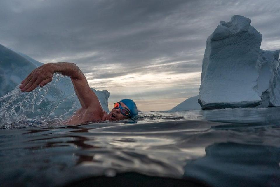 Lewis Pugh swimming among icebergs to to highlight the impacts of the climate crisis  (Olle Nordell/Lewis Pugh Foundation/PA)