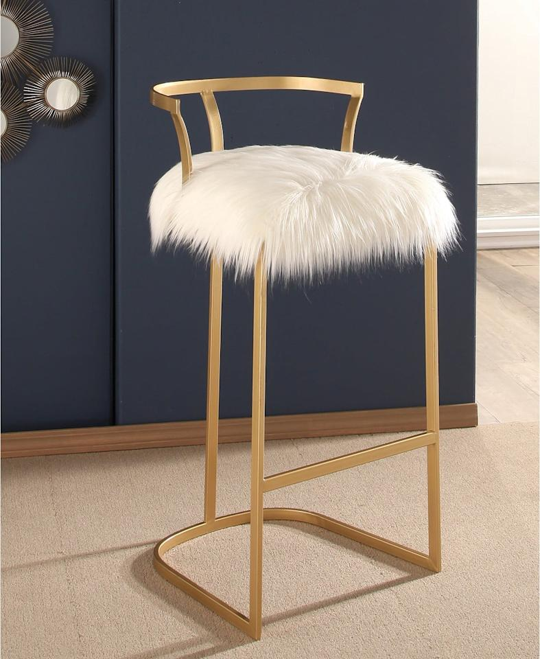 """<p>Add some glam to your bar area with this <a href=""""https://www.popsugar.com/buy/Abbyson%20Living%20Gisele%20Faux%20Fur%20Bar%20Stool-472501?p_name=Abbyson%20Living%20Gisele%20Faux%20Fur%20Bar%20Stool&retailer=macys.com&price=149&evar1=casa%3Aus&evar9=46422177&evar98=https%3A%2F%2Fwww.popsugar.com%2Fhome%2Fphoto-gallery%2F46422177%2Fimage%2F46422185%2FAbbyson-Living-Gisele-Faux-Fur-Bar-Stool&list1=shopping%2Cfurniture%2Cmacys%2Chome%20shopping&prop13=mobile&pdata=1"""" rel=""""nofollow"""" data-shoppable-link=""""1"""" target=""""_blank"""" class=""""ga-track"""" data-ga-category=""""Related"""" data-ga-label=""""https://www.macys.com/shop/product/gisele-faux-fur-bar-stool-quick-ship?ID=4921059&amp;CategoryID=176345#fn=sp%3D1%26spc%3D52%26ruleId%3D78%7CBOOST%20ATTRIBUTE%7CBOOST%20SAVED%20SET%26searchPass%3DmatchNone%26slotId%3D23"""" data-ga-action=""""In-Line Links"""">Abbyson Living Gisele Faux Fur Bar Stool</a> ($149, originally $379).</p>"""
