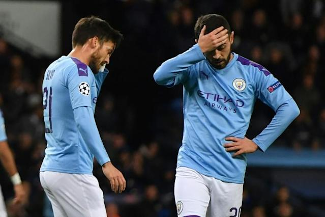 Manchester City are in shock after their ban from UEFA competitions (AFP Photo/Anthony Devlin)