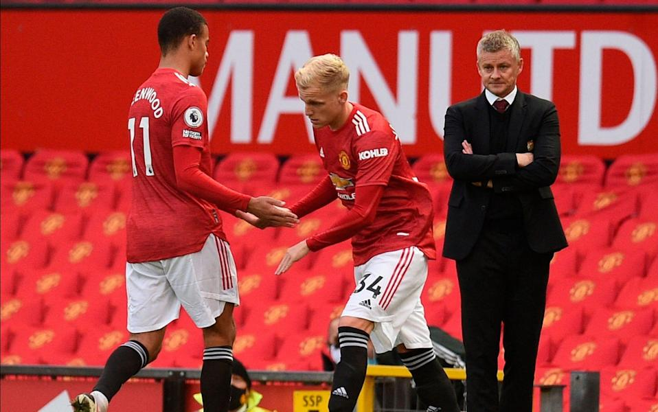 Manchester United's Donny van de Beek (R) walks in for Manchester United's Mason Greenwood (L) during the English Premier League match between Manchester United and Tottenham Hotspur in Manchester, Britain, 04 October 2020. - Oli Scarff/POOL/EPA-EFE/Shutterstock