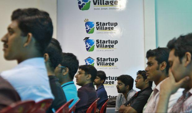 Entrepreneurs, employees and students listen to a speech during the Start-up saturday event at the Start-up Village in Kinfra High Tech Park in the southern Indian city of Kochi October 13, 2012. Three decades after Infosys, India's second-largest software service provider, was founded by middle-class engineers, the country has failed to create an enabling environment for first-generation entrepreneurs. Startup Village wants to break the logjam by helping engineers develop 1,000 Internet and mobile companies in the next 10 years. It provides its members with office space, guidance and a chance to hobnob with the stars of the tech industry. But critics say this may not even be the beginning of a game-changer unless India deals with a host of other impediments - from red tape to a lack of innovation and a dearth of investors - that are blocking entrepreneurship in Asia's third-largest economy. To match Feature INDIA-TECHVILLAGE/ Picture taken October 13, 2012. REUTERS/Sivaram V (INDIA - Tags: BUSINESS SCIENCE TECHNOLOGY EMPLOYMENT) - GM1E8C403NH01