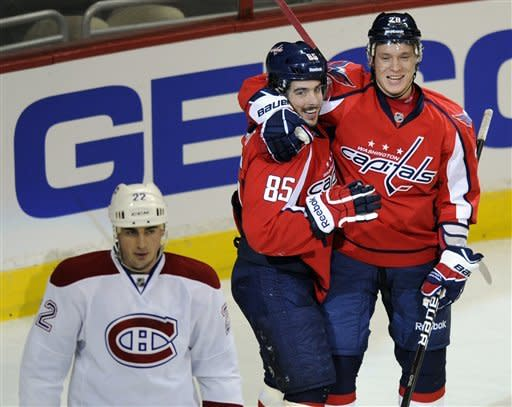 Washington Capitals center Mathieu Perreault (85) celebrates his goal with teammate left wing Alexander Semin, right, of Russia, as Montreal Canadiens defenseman Tomas Kaberle (22), of The Czech Republic, looks on during the first period of an NHL hockey game, Friday, Feb. 24, 2012, in Washington. (AP Photo/Nick Wass)