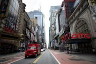 A truck drives along normally bustling 42nd Street in Manhattan on June 30, 2020