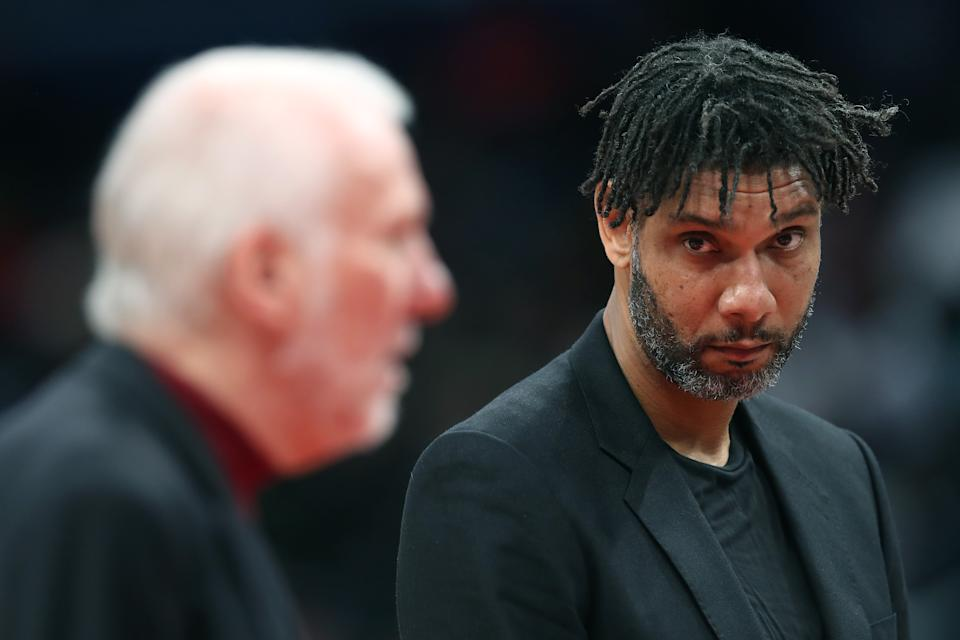 WASHINGTON, DC - NOVEMBER 20: Assistant coach Tim Duncan (R) looks on as head coach Gregg Popovich of the San Antonio Spurs talks with an official in the first half against the Washington Wizards at Capital One Arena on November 20, 2019 in Washington, DC.  NOTE TO USER: User expressly acknowledges and agrees that, by downloading and/or using this photograph, user is consenting to the terms and conditions of the Getty Images License Agreement.  (Photo by Rob Carr/Getty Images)