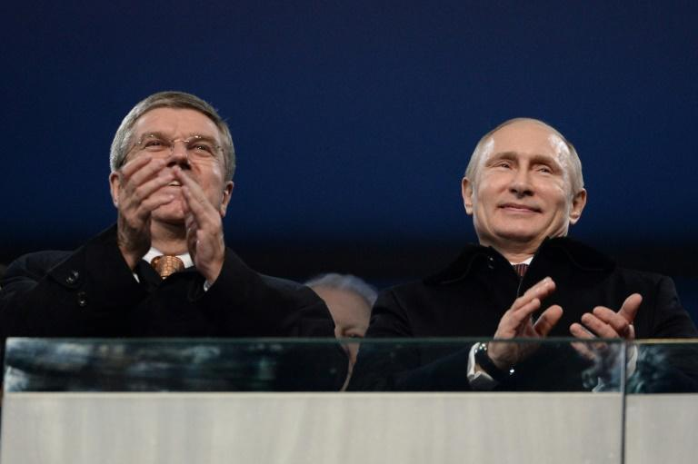 Russian President Vladimir Putin (R), seen here at the Sochi Winter Games with International Olympic Committee chief Thomas Bach, did not mention Russia's Games ban in a farewell speech to athletes