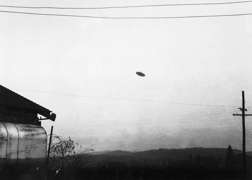 """<p>On May 11, 1950, a farmer in McMinnville, Oregon, captured a photo of what appears to be a flying saucer. According to a regional magazine, this is <a href=""""https://bitterrootmag.com/2019/05/24/70-years-after-famous-sighting-oregon-town-still-believes-in-ufos/"""" rel=""""nofollow noopener"""" target=""""_blank"""" data-ylk=""""slk:one of the most famous photos within the UFO community"""" class=""""link rapid-noclick-resp"""">one of the most famous photos within the UFO community</a> — so much so that the northwestern town now holds an annual UFO Festival. </p>"""