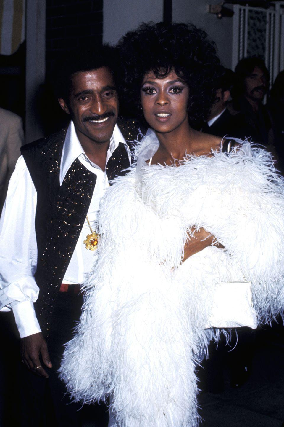 <p>Lola Falana sure knew how to accessorize—a feather boa was the perfect touch to add a little drama to a classic black gown. </p>