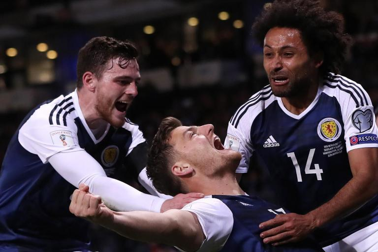Chris Martin ignores Scotland boos as Fulham striker saves Gordon Strachan