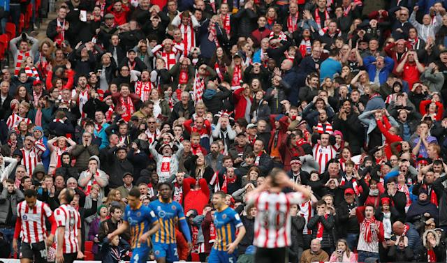 "Soccer Football - Checkatrade Trophy Final - Lincoln City vs Shrewsbury Town - Wembley Stadium, London, Britain - April 8, 2018 Lincoln City fans react after Lincoln City's Matt Rhead (2nd L) misses a chance to score Action Images/Andrew Boyers EDITORIAL USE ONLY. No use with unauthorized audio, video, data, fixture lists, club/league logos or ""live"" services. Online in-match use limited to 75 images, no video emulation. No use in betting, games or single club/league/player publications. Please contact your account representative for further details."