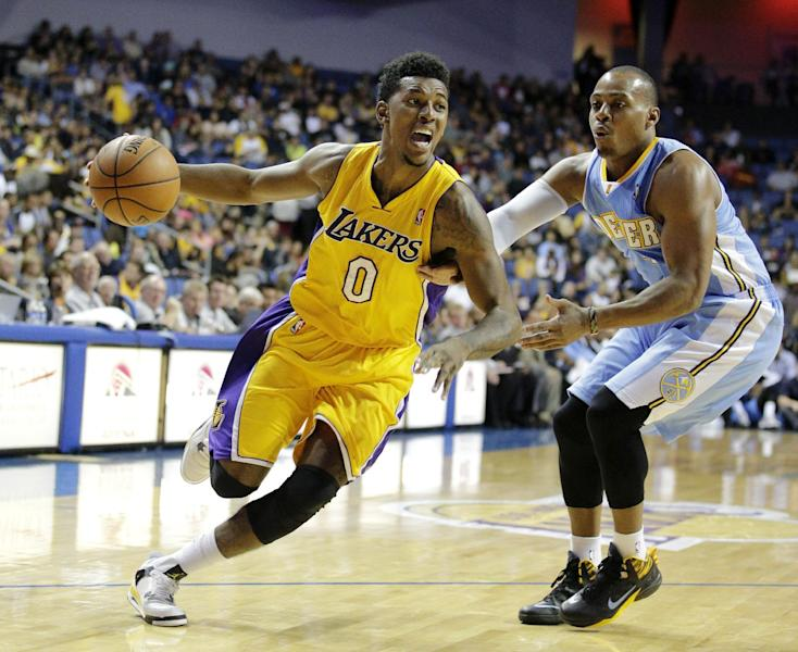 Los Angeles Lakers' Nick Young, left, drives past Denver Nuggets' Randy Foye in the first half of an NBA preseason basketball game Tuesday, Oct. 8, 2013, in Ontario, Calif. (AP Photo/Jae C. Hong)