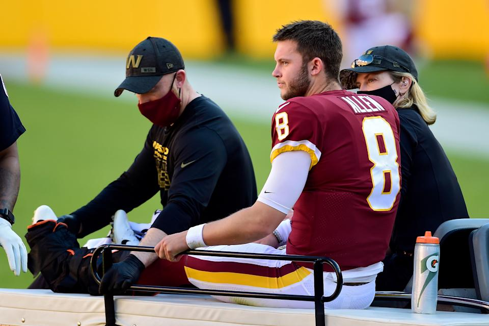 LANDOVER, MARYLAND - NOVEMBER 08: Kyle Allen #8 of the Washington Football Team is carted off the field after being injured in the first quarter against the New York Giants at FedExField on November 08, 2020 in Landover, Maryland. (Photo by Patrick McDermott/Getty Images)