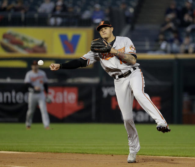 Baltimore Orioles' Manny Machado throws out Chicago White Sox's Yolmer Sanchez at first during the third inning of a baseball game Monday, May 21, 2018, in Chicago. (AP Photo/Charles Rex Arbogast)
