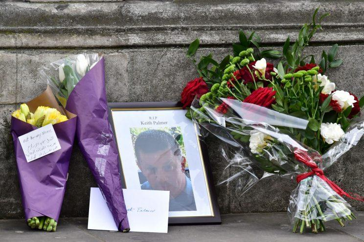 Flowers are left at the National Police Memorial on The Mall in London (PA Images)