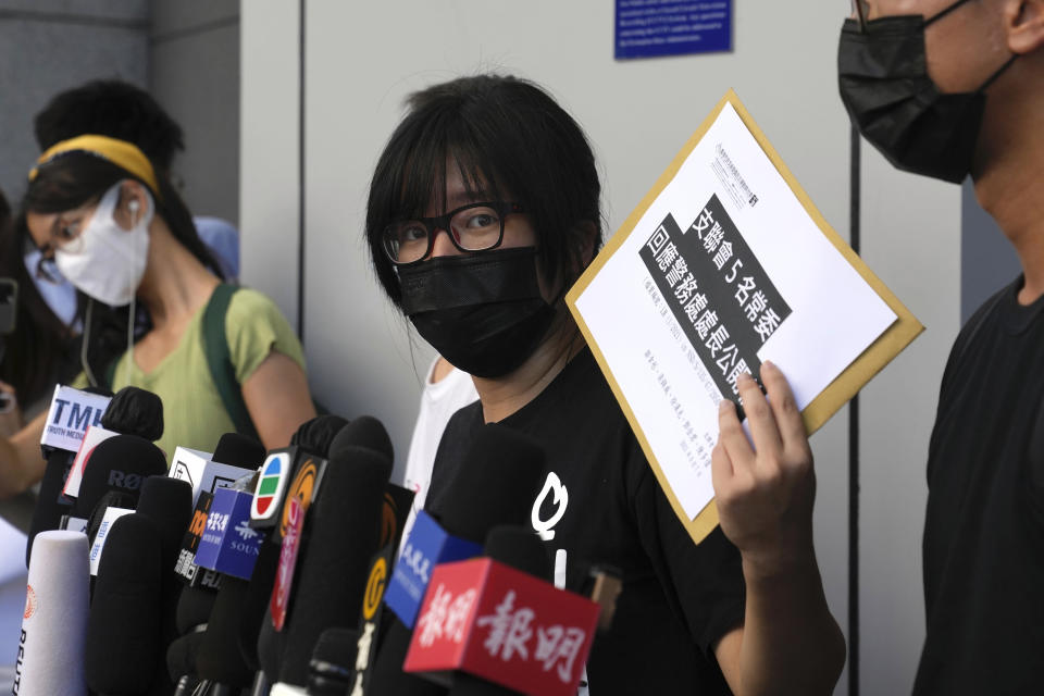 Chow Han Tung, vice chairwoman of the Hong Kong Alliance in Support of Patriotic Democratic Movements of China, speaks to media before delivering a letter to the police to reject their information request at the police headquarters in Hong Kong, Tuesday, Sept. 7, 2021. The group said the Hong Kong government is arbitrarily labeling pro-democracy organizations as foreign agents so they can be prosecuted under a tough national security law, Tuesday. (AP Photo/Kin Cheung)