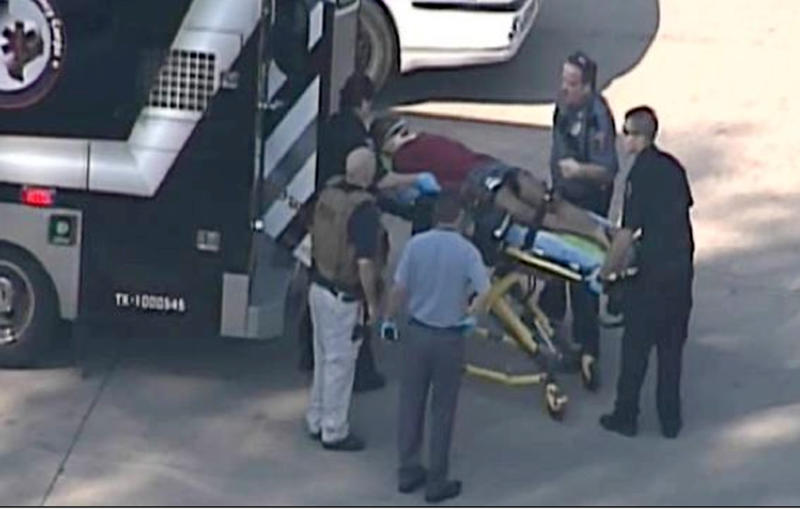 In this frame grab provided by KPRC Houston, an unidentified person is transported by emergency personnel at Lone Star College Tuesday, Jan. 22, 2013, in Houston, where law enforcement officials say the community college is on lockdown amid reports of a shooter on campus. (AP Photo/Courtesy KPRC TV) MANDATORY CREDIT