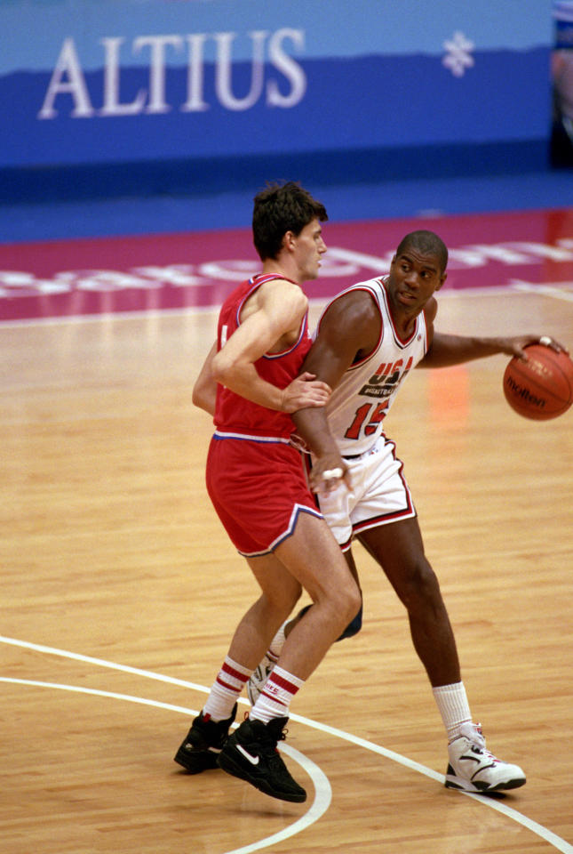 "BARCELONA, SPAIN - AUGUST 8:  Earvin Magic Johnson #15 of the United States moves the ball in the 1992 Olympic game against Croatia on August 8, 1992 in Barcelona, Spain. The ""Dream Team"" defeated Croatia 117-85. NOTE TO USER: User expressly acknowledges and agress that, by downloading and or using this photograph, User is consenting to the terms and conditions of the Getty Images License Agreement. (Photo by Shaun Botterill/Getty Images)"