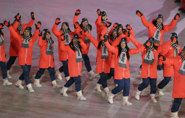 <p>Japan's boot-to-jacket combo, with the matching laces, were excellent, especially when coupled with the gray scarves and orange and black gloves. </p>