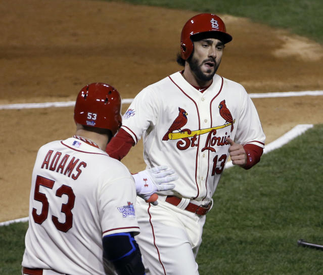 St. Louis Cardinals' Matt Carpenter (13) is congratulated by teammate Matt Adams after scoring during the first inning of Game 3 of baseball's World Series against the Boston Red Sox Saturday, Oct. 26, 2013, in St. Louis. (AP Photo/David J. Phillip)