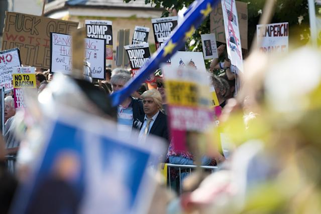 <p>Protesters gather at the gates of Blenheim Palace where President Trump is due to visit for dinner on July 12, 2018, in Oxfordshire, England. (Photo: Matt Cardy/Getty Images) </p>