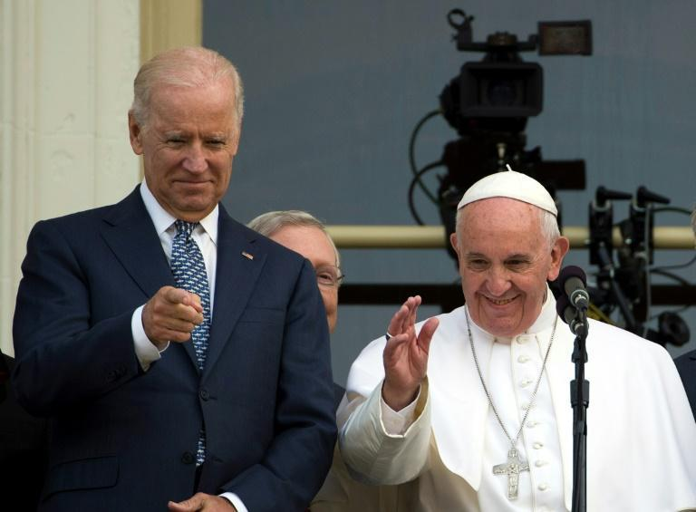 Then-vice president Joe Biden (L) welcomed Pope Francis to the US Capitol in September 2015, with the pontiff delivering a speech to a joint session of Congress