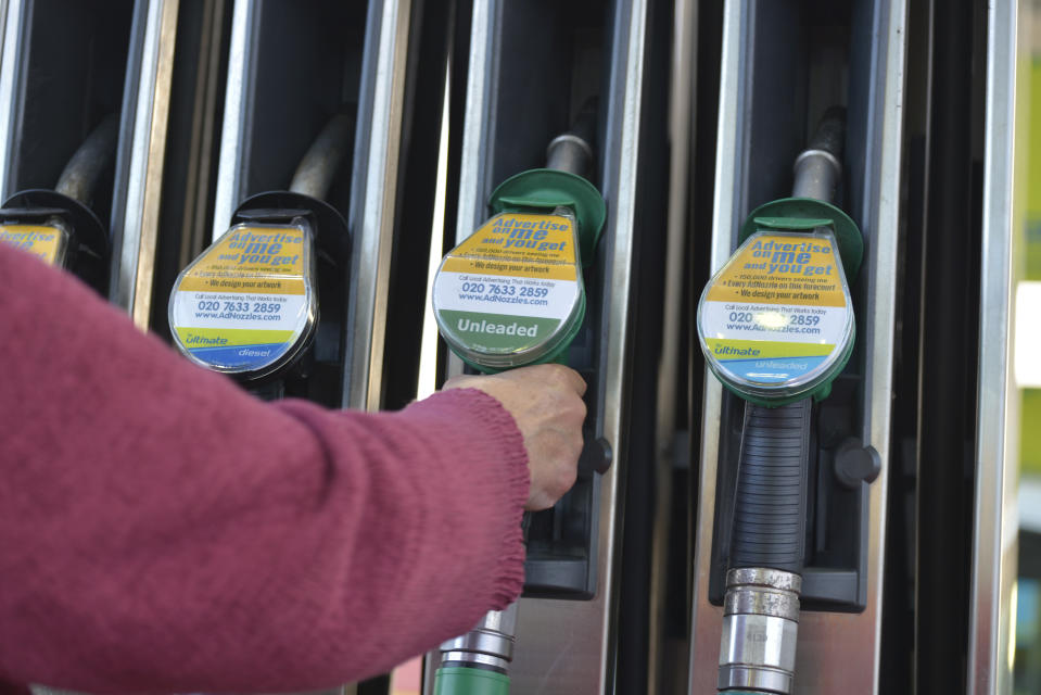 A person takes hold of a petrol pump at a British Petroleum petrol station on November 2, 2016 in Bolton, England. (Photo by Jonathan Nicholson/NurPhoto via Getty Images)