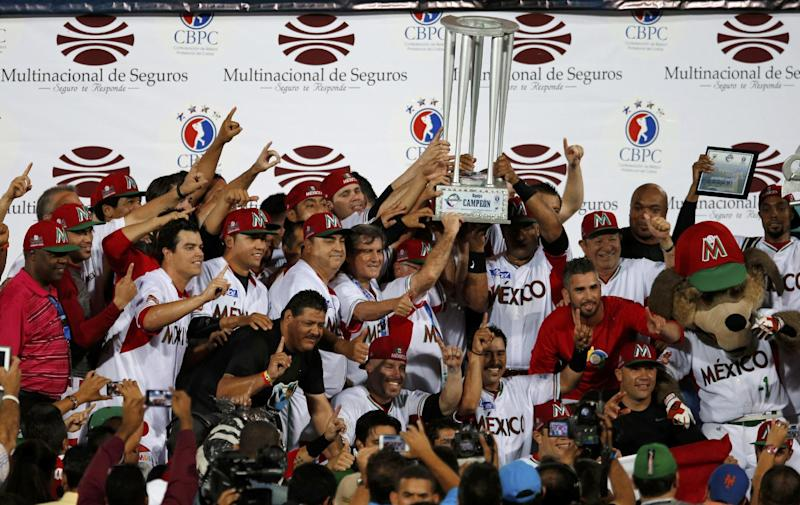 Mexico players raise the trophy as champions of Caribbean Series baseball tournament in Porlamar, Venezuela, Saturday, Feb. 8, 2014. Mexico defeated Puerto Rico 7-1 in the final