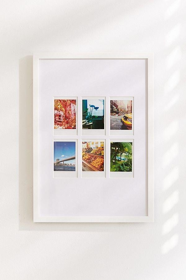 <p>Allow your kid to show off their photography skills with this <span>Instax Gallery Photo Frame</span> ($29).</p>