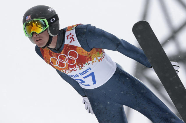 United States' Bill Demong makes his trial jump during the Nordic combined individual Gundersen large hill competition at the 2014 Winter Olympics, Tuesday, Feb. 18, 2014, in Krasnaya Polyana, Russia. (AP Photo/Matthias Schrader)