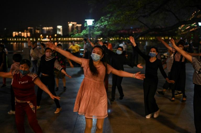 Life is slowly returning to normal in Wuhan, where a coronavirus lockdown was lifted in April (AFP Photo/Hector RETAMAL)