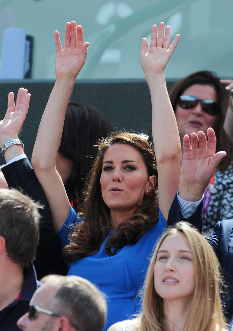 <p>She wore the same Stella McCartney dress to Wimbledon. Best part: She did the wave. </p>
