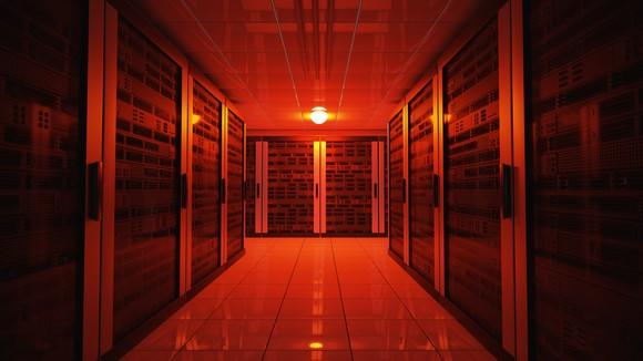 A data center illuminated by a red light.