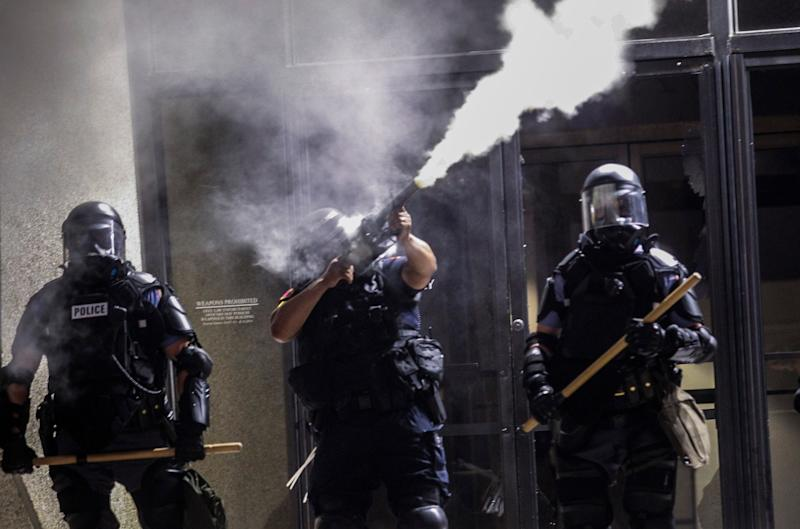 Police in riot gear fire tear gas at protesters in Raleigh, NC: AP