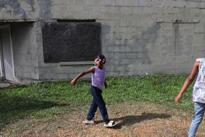 Fanny Love, 5, walks through her neighborhood in Greenwood, Miss., Saturday, June 8, 2019. Fanny's uncle, Joshua K. Love, says he was sexually abused by two Franciscan Friars at a local Catholic grade school. (AP Photo/Wong Maye-E)