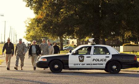 "Major General Terry M. ""Max"" Haston (2nd L), Adjutant General Tennessee National Guard tours the scene of a shooting at the National Guard Armory in Millington"