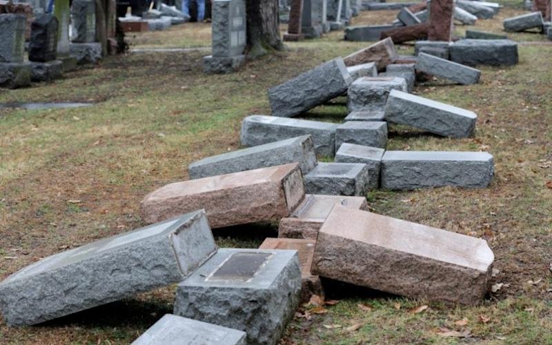 A row of more than 170 toppled Jewish headstones is seen after a weekend vandalism attack on Chesed Shel Emeth Cemetery - Credit: Reuters