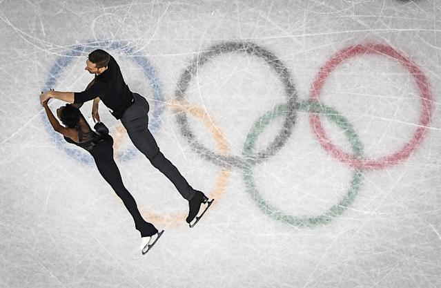 <p>France's Vanessa James and France's Morgan Cipres compete in the pair skating free skating of the figure skating event during the Pyeongchang 2018 Winter Olympic Games at the Gangneung Ice Arena in Gangneung on February 15, 2018. / AFP PHOTO / ARIS MESSINIS </p>