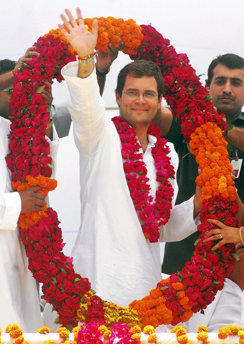 FILE – In this April 18, 2009 file photo, Congress party General Secretary Rahul Gandhi waves to the crowd as he is felicitated by party workers with a garland during an election rally in Amethi, India.   Gandhi was appointed Vice President of the party at a special two-day long party seminar on Saturday, Jan. 19, 2013. (AP Photo/Manish A., File)