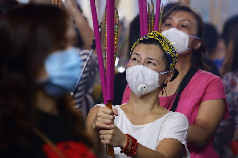 SINGAPORE - JANUARY 24: Worshippers wearing mask, gather to pray at the Kwan Im Thong Hood Cho Temple on January 24, 2020 in Singapore. Singapore confirmed another two cases of the Wuhan viruses today, making a total of three, as Singapore prepares to usher in the Year of the Rat, one of the most anticipated holidays on the Chinese calendar. Also known as the Spring festival or the Lunar New Year, the celebrations last for about 15 days. (Photo by Suhaimi Abdullah/Getty Images)