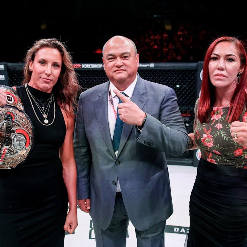 Julia Budd and Cris Cyborg Justino (right) at the announcement of their Bellator featherweight title bout with president Scott Coker   - Lucas Noonan/Bellator