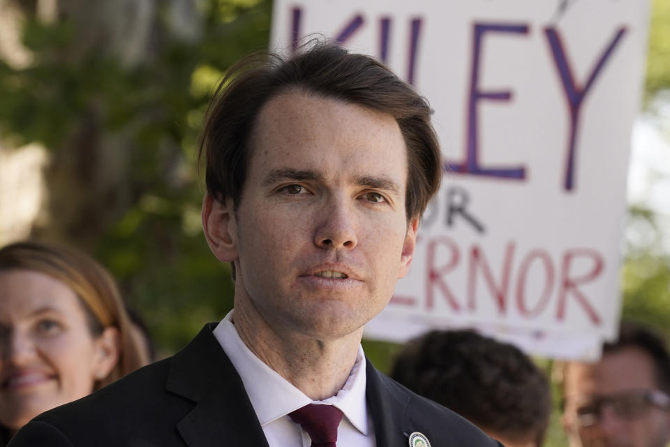 FILE — In this July 21, 2021 file photo Assemblyman Kevin Kiley, of Rocklin, a Republican candidate for governor in the Sept. 14 recall election, campaigns for school choice outside a charter school in Sacramento, Calif. Kiley is is one of several high-profile Republicans, who is running to replace Gov. Gavin Newsom in the Sept. 14 recall election. Kiley and three other Republican candidates are heading into their first televised debate, to be held Wednesday, Aug. 4, 2021. Conservative talk radio host Larry Elder and reality tv personality Caitlyn Jenner will not attend the debate. (AP Photo/Rich Pedroncelli, File)