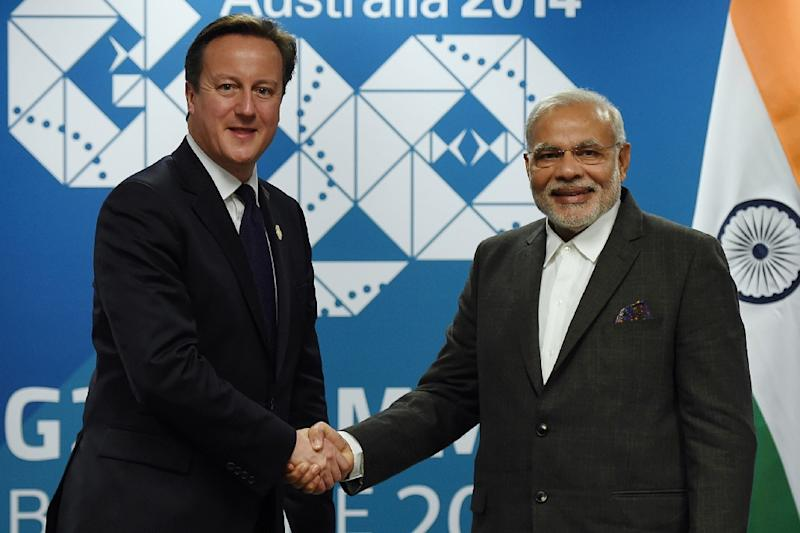British Prime minister David Cameron (L) shakes hands with Indian Prime Minister Narendra Modi during a bilateral meeting on the sidelines of the G20 Summit in Brisbane, Australia on November 12, 2015