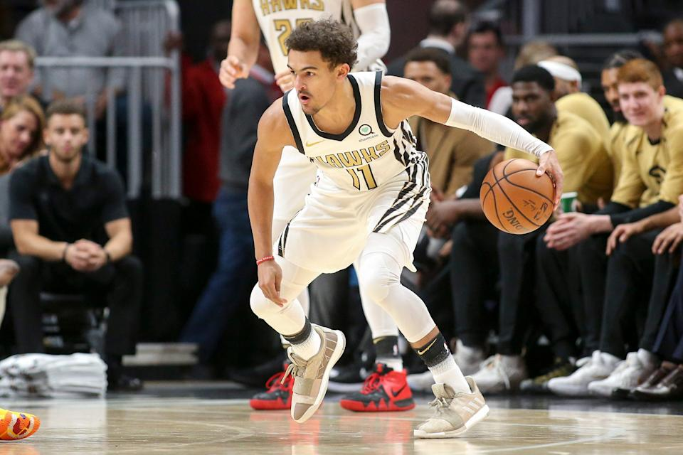 Atlanta Hawks guard Trae Young dribbles against the Detroit Pistons in the first quarter at State Farm Arena, Nov. 9, 2018 in Atlanta.